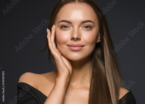 Obraz Female face beauty woman long hair fly natural make up clean healthy skin hand touching face - fototapety do salonu