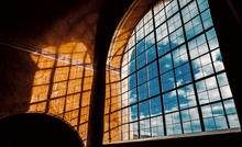 Large Arched Window Has Blue S...