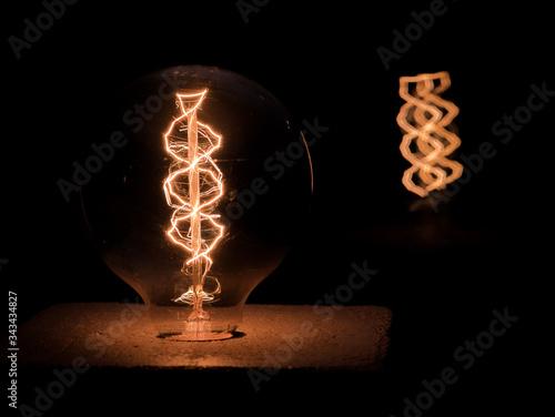 Close-up Of Illuminated Light Bulb Canvas Print
