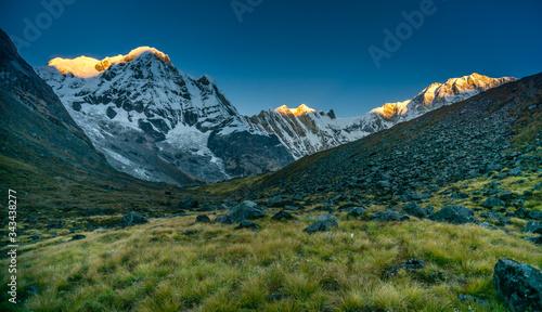 Annapurna South and Annapurna mountains with alpenglow during a sunrise near Annapurna Base Camp фототапет