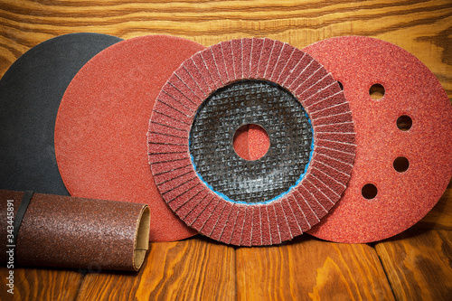 Photo Set of abrasive tools and sandpaper on vintage wooden background