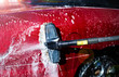 canvas print picture - Hand washing with brush and compressor of a red car.