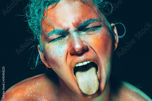 Obraz na plátne Tongue woman body art toxic skin color emotional face beauty abstract