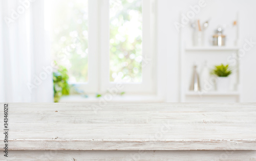Free space table top background on blurred kitchen window interior Fototapet