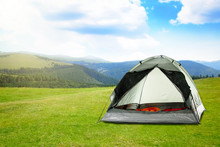 Modern Camping Tent In Mountains On Sunny Day