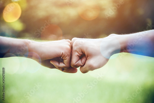 Hands of two man people fist bump team teamwork and partnership business success Fotobehang