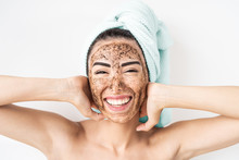 Young Smiling Woman Applying C...