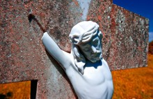 Close-up Of Broken Jesus Christ Statue On Cross