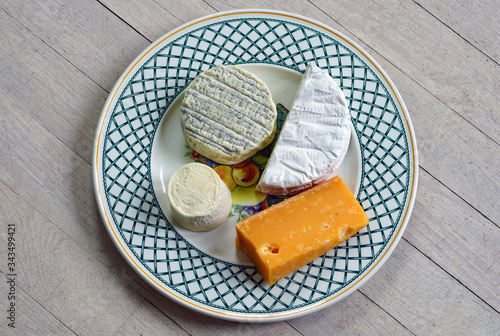 A gourmet cheese platter with ripened goat cheese, camembert and aged gouda Tablou Canvas