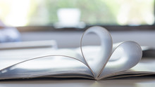 Heart Shaped Books On A Table ...