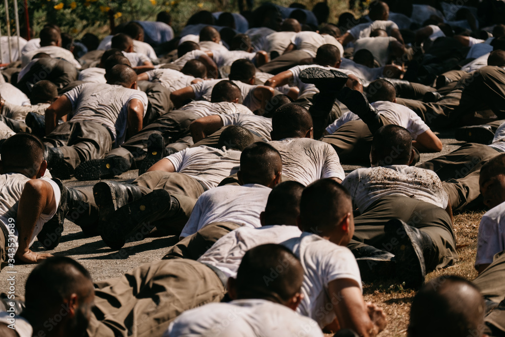 Fototapeta Soldiers game on military training ground ( battle camp ). Action. Operation Trainer giving training to military soldiers at boot camp Heavily Hot sun