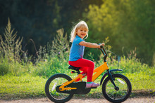 Cute Happy Little Girl Riding ...