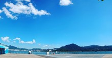 Empty Promenade By River Against Sky At Tai Po Waterfront Park