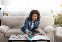 Young Black Woman Drawing Pict...