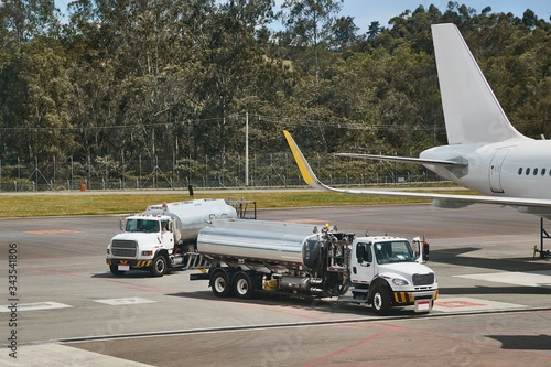 Tank truck at an airport to refuel a jet aircraft, airliner refuelling Canvas Print