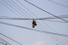 Shoes On Electric Cable