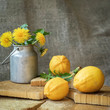Bright organic lemons, natural vitamin C and an old aluminum can with dandelions on a natural wooden background, vintage