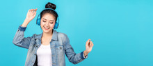Young Happy Attractive Asian Woman Using Headphone Enjoy Listen To Song In Concept Of Next Normal Life, Pastime Or Hobby Online. Quarantine Activity Asian Lifestyle Listening To Music On Radio Online.