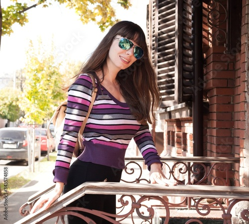 Woman, black leggings, striped sweater, sunglasses aviator Canvas Print