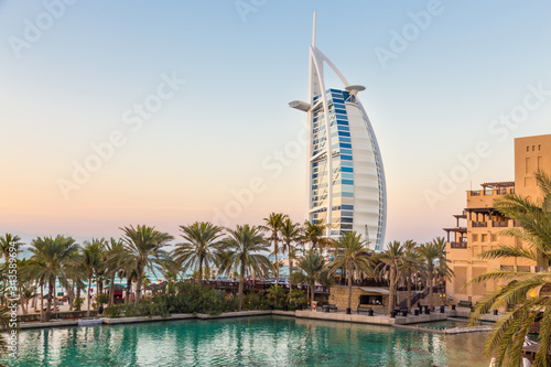 Plakat Dubai landmark, seven star luxury hotel Burj Al Arab at dusk, UAE.