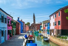 Boats In Canal With San Martino In Background At Burano
