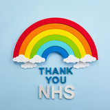 Fototapeta Rainbow - Thank you nhs rainbow banner. Rainbow ob blue background with letters