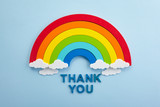 Fototapeta Tęcza - Thank you rainbow banner. Rainbow ob blue background with letters