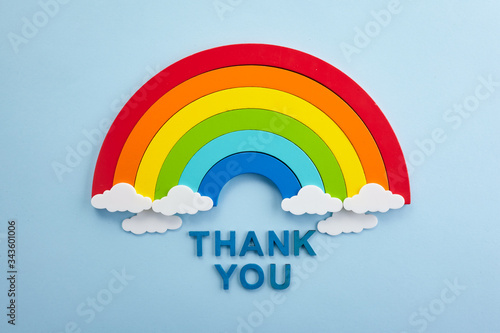 Thank you rainbow banner. Rainbow ob blue background with letters © vetre