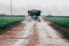 Water Spraying On Dirt Road Fr...