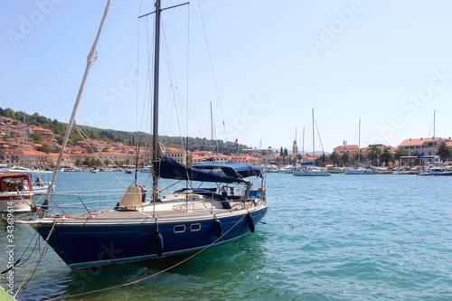 Fotografie, Obraz Sailing boat in the port of Vela Luka, on island Korcula, Croatia