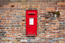 British Mailbox On A Brick Wall In England