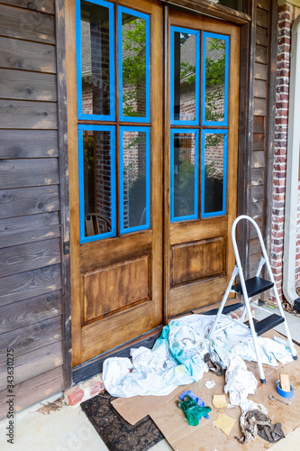 weathered Wooden door of a home being refinished with fresh stain and urethane coating Wall mural