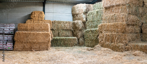 Haystacks sorted inside an agricultural modern warehouse in Extremadura at the Spanish countryside Wallpaper Mural