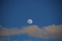 Low Angle View Of Moon In Sky