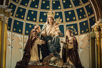 Mary, Jesus, St. Catherine and St. Dominic statue in Holy Rosary Church or Kalawar Church, Samphanthawong District, Bangkok, Thailand