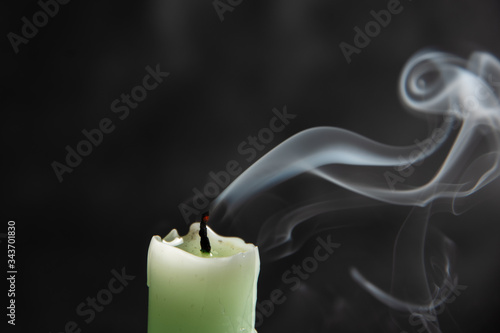 extinct light green candle with spectacular abstract smoke of a fanciful shape o Wallpaper Mural