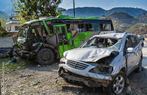 Fototapeta Parking of cars that were badly damaged as a result of accidents on mountain roads, falling into the abyss, collisions, falling under a rockfall