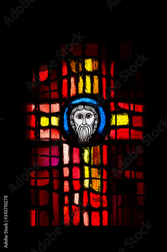 Stained glass on a black background in the shape of a cross in the Cathedral of Peter and Paul in Wissembourg Canvas Print
