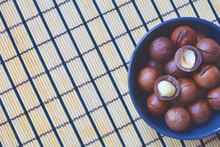 Macadamia Nuts In A Blue Bowl ...