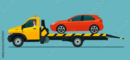 Tow truck with a driver carries a hatchback car Fotobehang