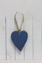 Blue Heart Hanging From Fence
