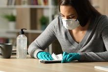 Woman Disinfecting Phone From ...