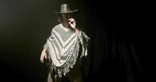 Cowboy Is Standing In A Dark R...