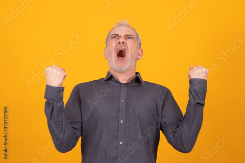 adult man with expression of success isolated on background Canvas Print