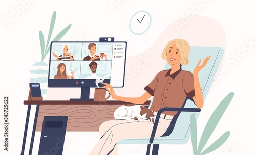 Young woman having videoconference with colleagues Wallpaper Mural