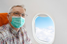 Man Wearing Mask In Aircraft C...