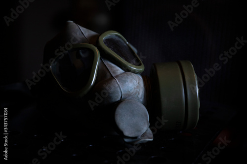 Military Gas Mask in dark ambient Wallpaper Mural