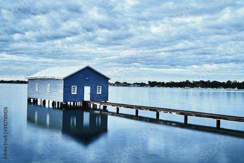 Fotografija Rustic blue house on the water