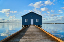 Rustic Blue House On The Water