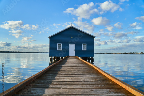 Valokuva Rustic blue house on the water